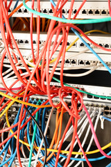 network panel from a school server with colorful ethernet cable on switches