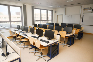 Computer classroom with monitors and keyboards for pupils and students in a school computer lab