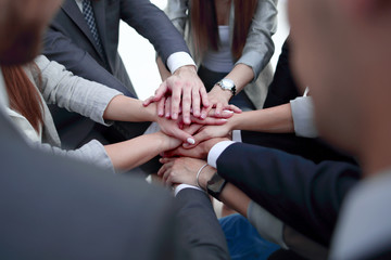 Close-Up of hands business team showing unity with putting their hands together.
