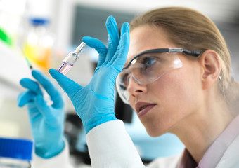 Pharmaceutical Research, Scientist preparing a new drug for testing in the laboratory