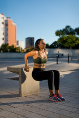 Young woman doing workout exercise in the city