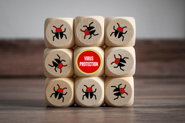 Cubes and dice with Internet security and anti virus protection on wooden background