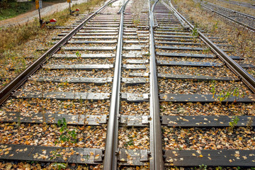 two railway lines going to the perspective of sunny days