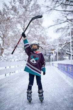 Portrait of a boy in ice hockey gear