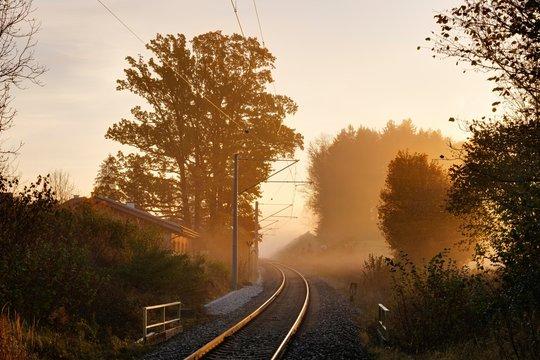 Railway tracks in the fog, sunrise, Tutzing, Funfseenland, Upper Bavaria, Bavaria, Germany, Europe