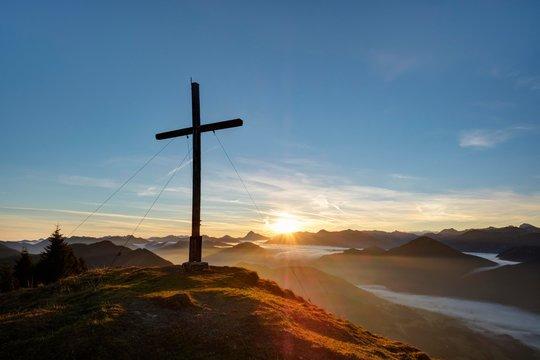 Sunrise, the summit cross at Hirschhornlkopf, Jachenau, Isarwinkel, Upper Bavaria, Bavaria, Germany, Europe
