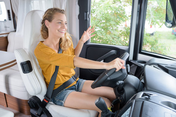 young lady driving modern campervan