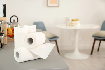 Rolls of paper towels on table in kitchen