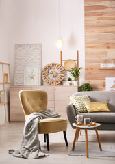 Stylish living room interior with comfortable sofa. Idea for home decor