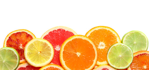 Slices of fresh citrus fruits on white background, top view