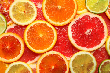 Wall Murals Slices of fruit Slices of fresh citrus fruits as background, top view