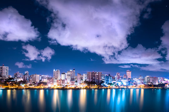 Beautiful Condado Beach, San Juan Puerto Rico seen at night with bay, buildings and lights