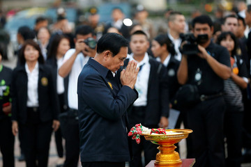 Thailand's Prime Minister Prayut Chan-o-cha pays respects at the late King Rama VI Monument statue as he visits Lumphini Park ahead of the general election, in Bangkok