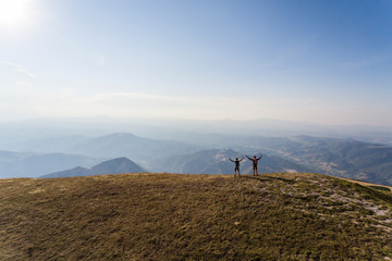Italy, Monte Nerone, two hikers on top of a mountain enjoying the view