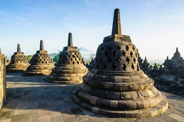 Indonesia, Java, Borobudur Temple Complex, stupas in early morning light