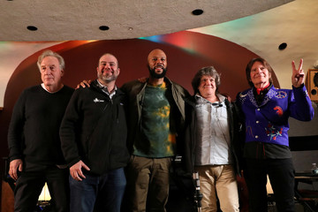 Comedy writer Alan Zweibel, HeadCount executive director Andy Bernstein, rapper Common, Woodstock producer Michael Lang and musician John Fogerty pose together after announcing the lineup for the Woodstock 50th Anniversary concert in New Yor