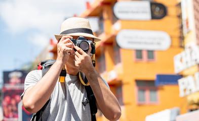 Tourist photographer taking picture in Khao san road Bangkok, Thailand