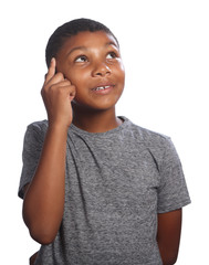 African American school boy looking up thinking