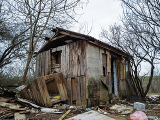 The left houses as a result of disaster. Full ruin of wooden constructions