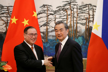 Chinese Foreign Minister Wang Yi and Philippine Foreign Secretary Teodoro Locsin Jr. attend a news conference after talks at the Diaoyutai State Guesthouse in Beijing