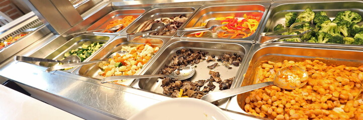 restaurant with many raw and cooked foods with many trays