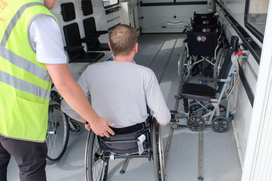 wheelchair traveler boarding an ambulift, disable tourist, handicapped person