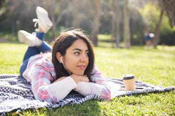 Serene girl listening to music in park