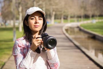 Serious young photographer at work