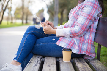 Student girl enjoying coffee break in park