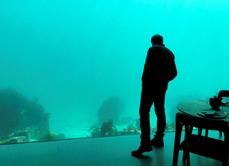 A man looks on during a media event at the underwater restaurant Under in Baaly