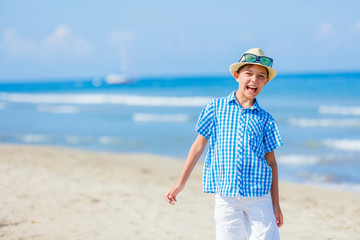 Portrait of Adorable boy having fun on the beach.