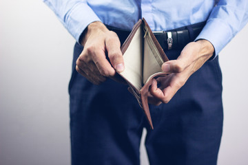young man holding empty wallet