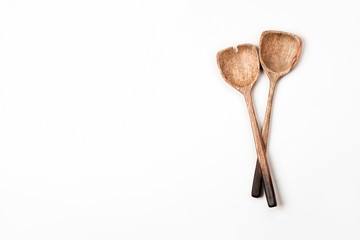 Two wooden Salad Spoons on white background. Flat lay, top view.