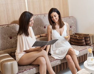 Pretty women sitting on sofa