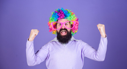 Foto op Canvas Carnaval Feel free to express yourself. Having fun. Holiday fun and carnival concept. Man bearded wear colorful wig and funny glasses on violet background. Clown and circus. Party fun. Enjoy being crazy