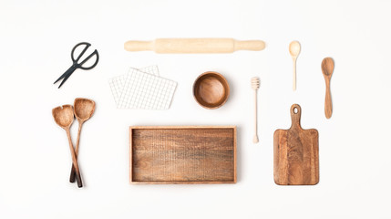 Wooden kitchen utensils on white background. Flat lay, top view.