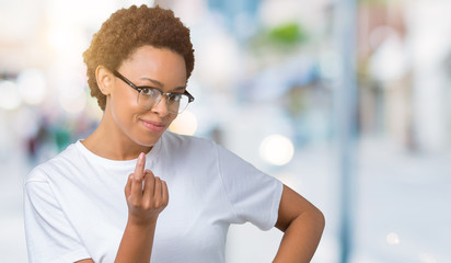 Beautiful young african american woman wearing glasses over isolated background Beckoning come here gesture with hand inviting happy and smiling