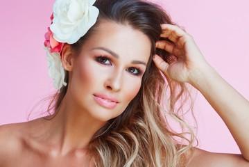 Closeup portrait of woman in pink makeup