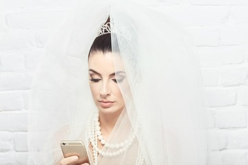 Bride using mobilephone