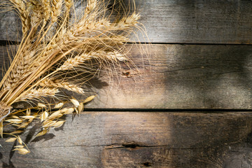 Shavout concept - grains, milk and cheese on wood background, top view
