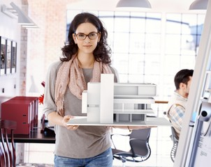 Attractive architect with scale model of building