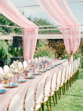Table setting at a luxury wedding reception. Outdoor wedding