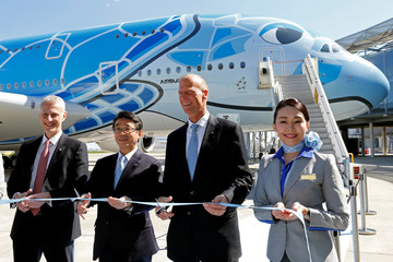 Airbus Chief Executive Tom Enders, Japan's ANA Holdings President and CEO Shinya Katanozaka and Chris Cholerton, President of Civil Aerospace at Rolls Royce pose during the delivery ceremony of the first A380 for All Nippon Airways (ANA) in Colomiers near