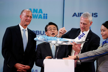 Airbus Chief Executive Tom Enders, Japan's ANA Holdings President and CEO Shinya Katanozaka and Chris Cholerton, President of Civil Aerospace at Rolls Royce pose during a news conference at the Airbus delivery center in Colomiers near Toulouse