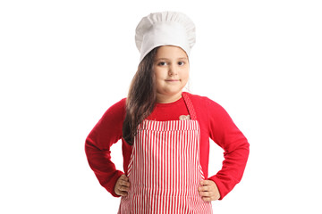 Little girl wearing apron and cooking hat