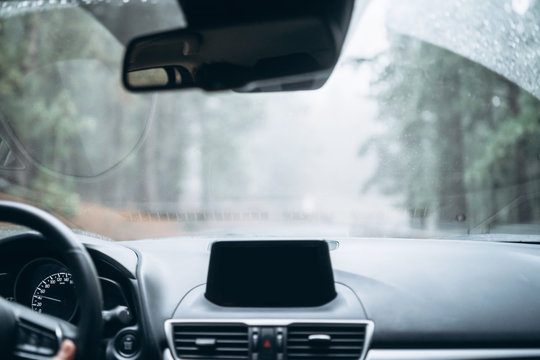 Man driving car with view from inside.