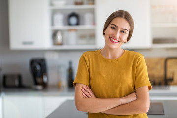Young woman standing in the kitchen