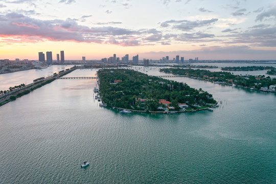 Palm Island and Hibiscus Island in Miami. Aerial view from helicopter at sunset