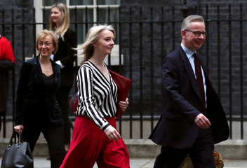 Britain's Secretary of State for Environment, Food and Rural Affairs Michael Gove, Chief Secretary to the Treasury Liz Truss and Conservative Party's leader of the House of Commons Andrea Leadsom are seen outside Downing Street in London