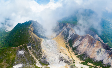Aerial view Sibayak volcano, active caldera steaming, travel destination in Berastagi, Sumatra, Indonesia.
